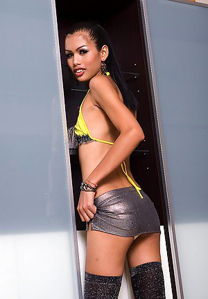 Tiny ladyboy Karn exposes her extremely small tits and tiny dick