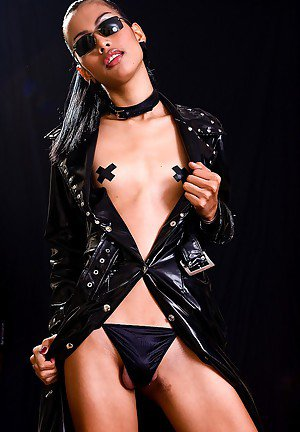 Hot ladyboy fetish model Karn in kinky latex coat with big cock out