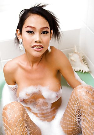 Young Asian tranny Wawa fingers her own asshole in the bathtub