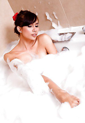 Bath time for sexy Asian tranny Nueng and her big shemale breasts