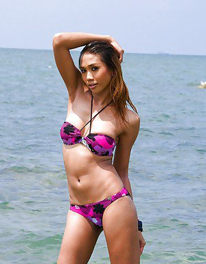 Sexy outdoor shoot with ladyboy Moo taking walk on beach in bikini