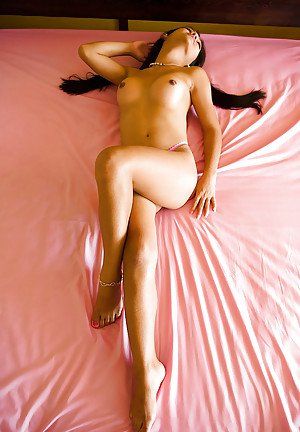 Hot Thai tranny Amy posing in her panties and rubbing her small cock