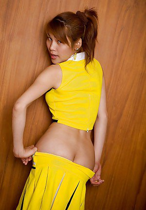 Nasty Thai shemale Cherry toying her shaved ass in a cheerleader uniform