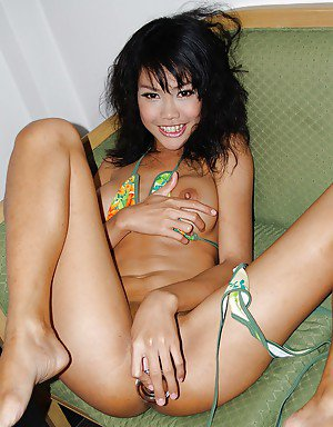 Kinky Asian tranny Wawa fingering her nasty pussy and spreading