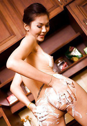 Skinny Asian ladyboy Jenny fucking her pussy on the kitchen counter