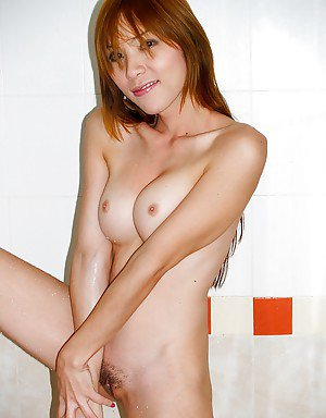 Horny Asian tranny Candy taking a shower and cleaning her dirty pussy