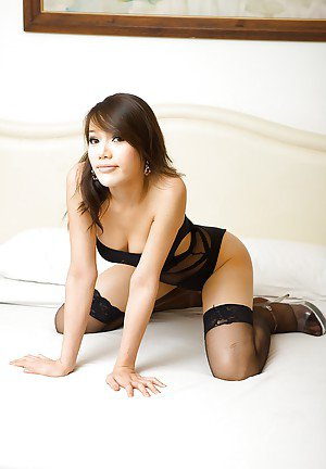 Horny Thai tranny Paula showing off her pussy in high heels and stockings