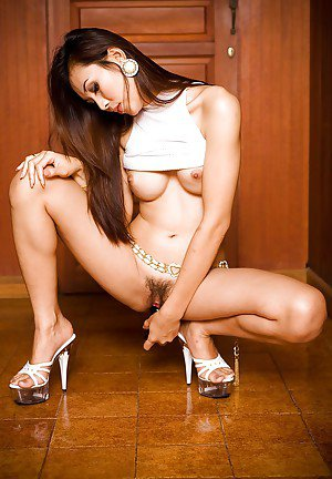 Pretty Asian ladyboy Jenny posing and fingering her hot tight pussy
