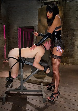 Gorgeous Asian shemale dominatrix Yasmin Lee stretching her slave's ass