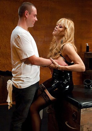 Kinky blonde shemale Johanna B jerking a guy off with her feet