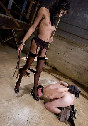 Charming Ebony tranny Mistress Soleli getting her cock hard in lingerie