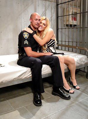 Busty blonde tranny Jesse getting fucked by an officer in her cell