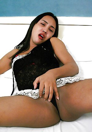 Gorgeous Asian ladyboy jerking off her big shaved cock in lingerie