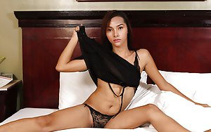 Small tit Asian tranny showing off her small dick and spreading her ass