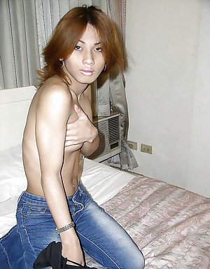 Petite Asian shemale strips off denim jeans and top to flash tiny boobs