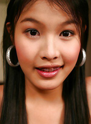Cute Asian shemale with braces Eyrika spreading in high heels