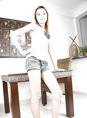 Skinny Asian ladyboy Pim showing off her ass and playing with a toy