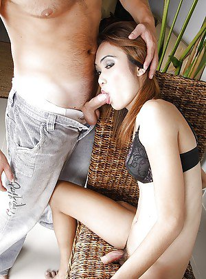 Slutty Thai tranny Pim giving a hard cock a treat with her sloppy mouth