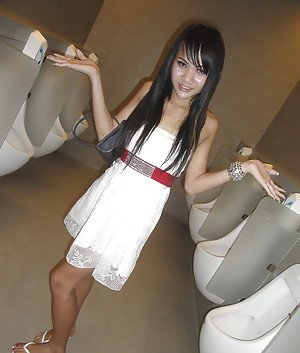 Cute skinny Asian tranny Mon posing outdoors and showing her cock