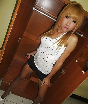 Cute redhead Thai ladyboy Nan posing and playing with her small cock