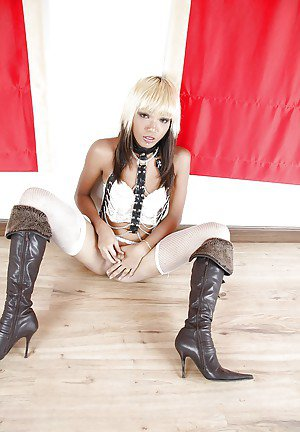 Exotic Asian shemale Sea spreading her legs in high heel boots