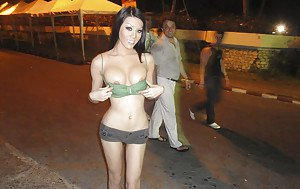 Sexy Thai shemale Army shows off her big tranny tits on public street