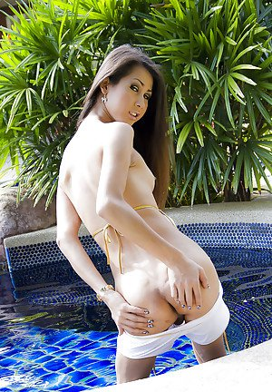 Hot Asian tranny Lisa showing off her small tits outdoors by the pool