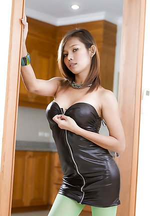 Exotic ladyboy Top posing busty body in sexy leather and boots outfit