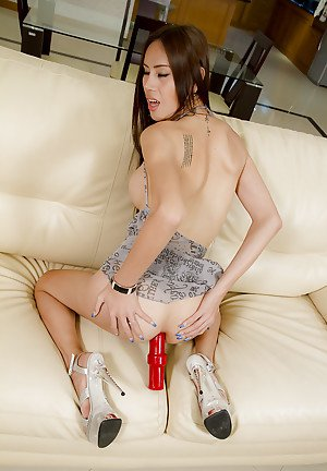 Tall Asian shemale Bow looking hot and sexy in dress and high heels