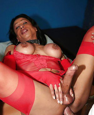 Busty Ebony tranny stretching a guy's anus with her cock in lingerie
