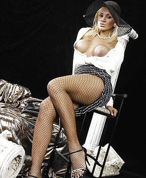 Glamorous big tit tranny in pantyhose having fun with a tight asshole