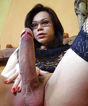 Dirty brunette tranny with glasses deep dicking an asshole in stockings