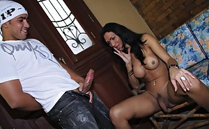 Busty and hot Latina tranny Cybelle Calmon giving a blowjob to a big cock