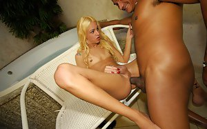Pretty blond shemale Dani removes panties for bareback ass pounding