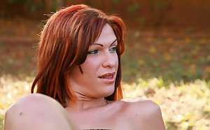 Cute redhead Latina shemale Kawanni enjoying a cumshot outdoors