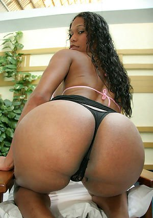 Big ass Latina shemale Paola showing off her huge boobs and cock