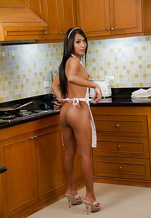 Small tit brunette Asian ladyboy Mint making some hot dogs in the kitchen