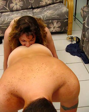 Slutty mature Latina shemale Tiffany getting on her knees and sucking