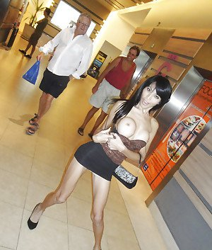 Big tit Asian tranny Fon posing outdoors and flashing her boobs in public