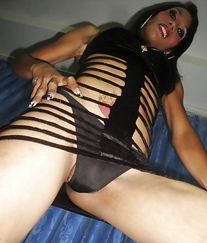 Big tit brunette Thai tranny M showing off her boobs outside in high heels