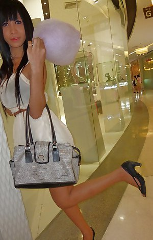 Cute Asian tranny Noot eating cotton candy and posing in high heels