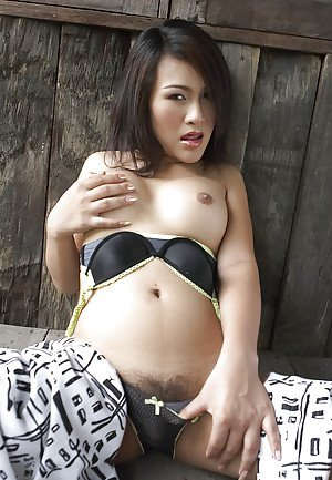 Pretty young Asian shemale Gelly has a perfect set of tranny boobs