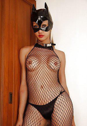 Kinky Asian tranny Natalie posing in fishnet bodystocking and mask