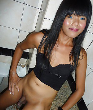 Cute Thai ladyboy Oil jacking off tiny shaved shecock in bathroom