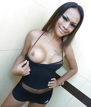 Cute Asian shemale May flashing her big tranny tits in public