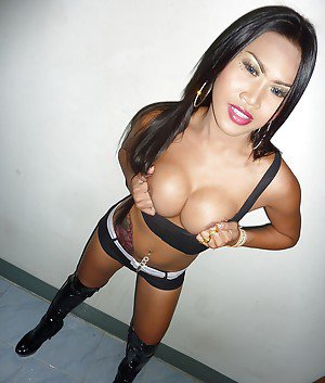 Gorgeous busty Thai tranny Fon spreading her ass and jerking off