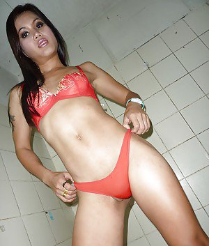 Beautiful Asian ladyboy Noi stripping in high heels and spreading her ass