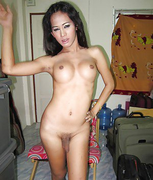 Horny Thai tranny Nadia playing with her big boobs in public and spreading