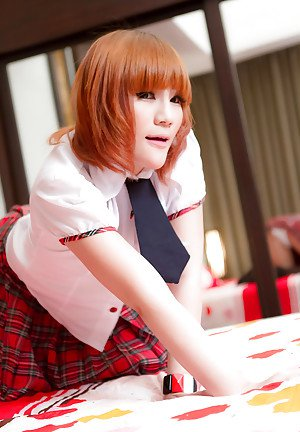 Redhead Asian shemale Nanny stripping out of her hot schoolgirl uniform