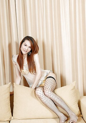 Skinny Asian tranny Micky jerking her stiff rod in fishnet stockings